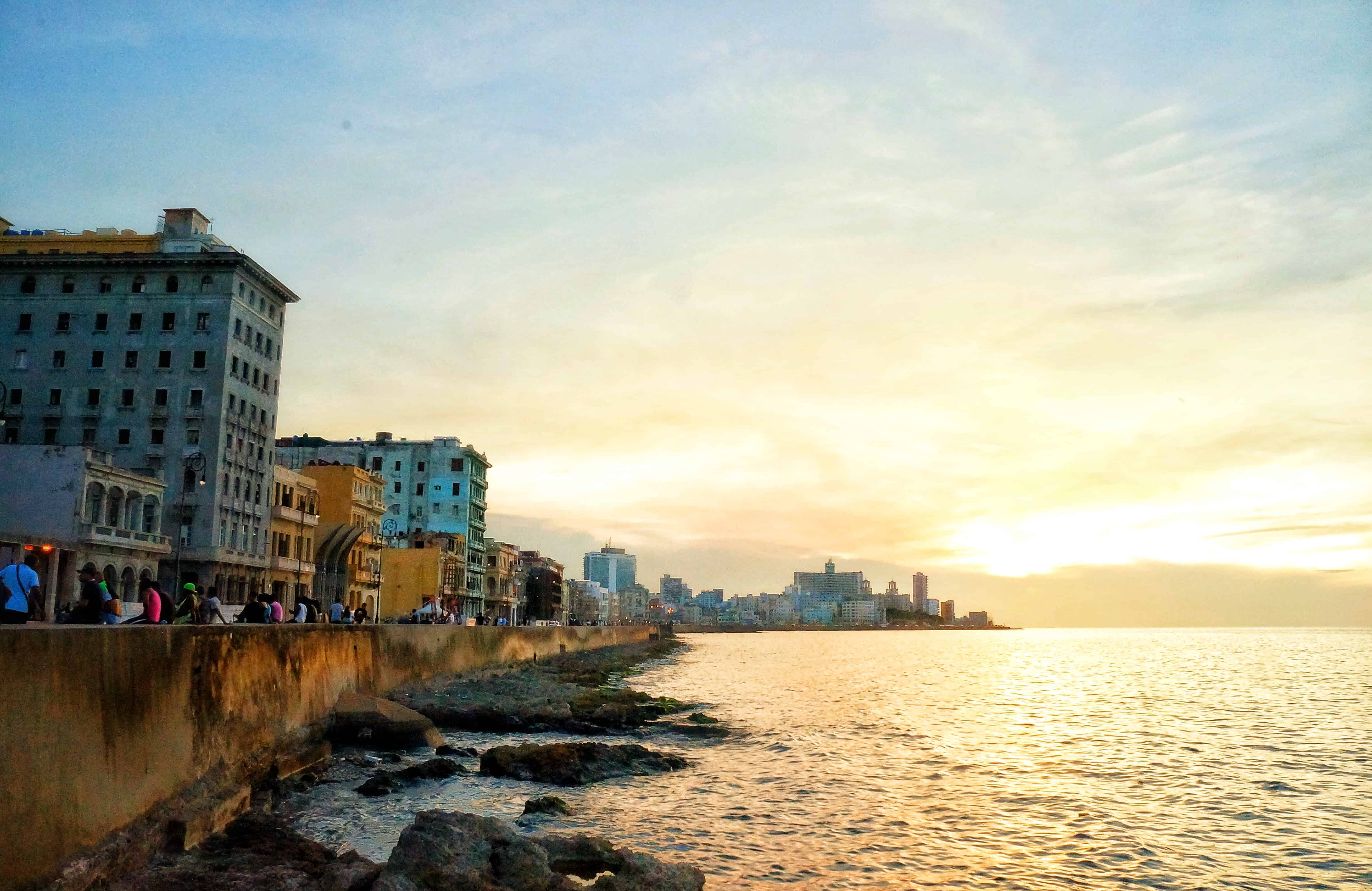 a sunset view of the famous malecón in havana cuba
